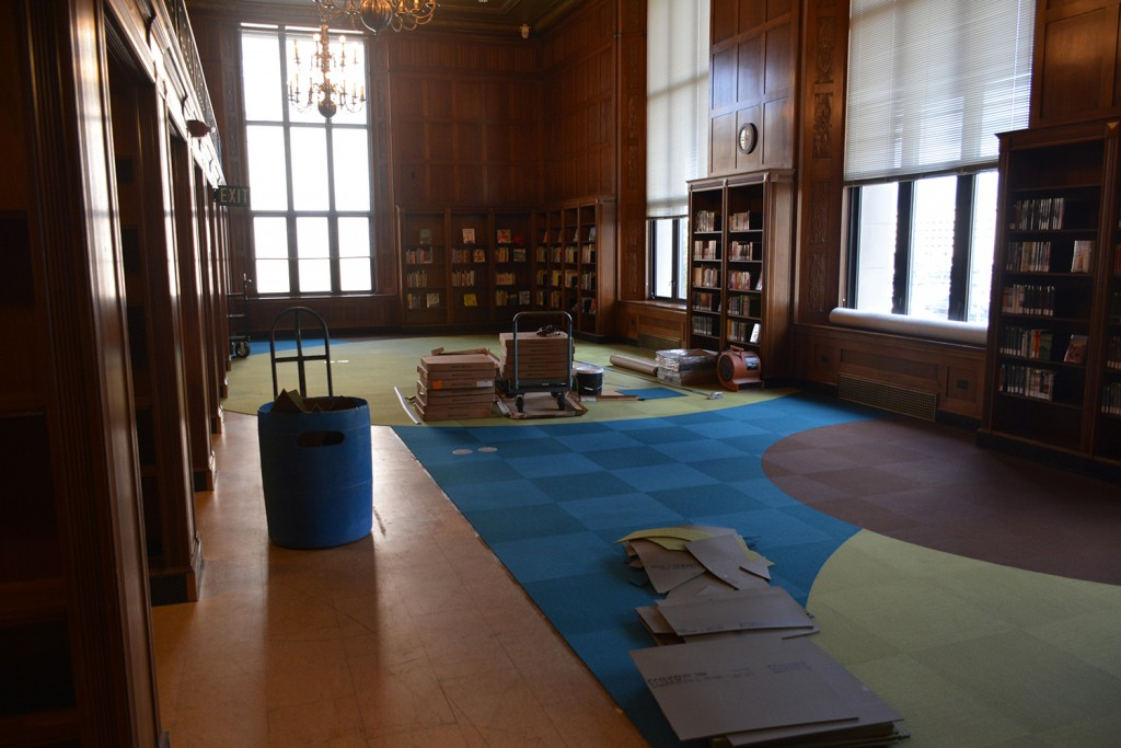 Progress: The new carpet being installed in the new Indiana Young Readers Center. The carpet brightens the room, but coordinates nicely with the natural colors of the woodwork original to the building.