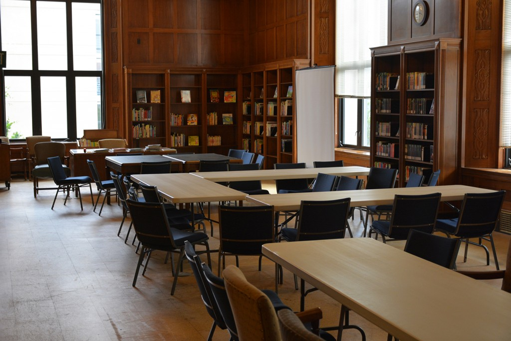 Before: The location for the Indiana Young Readers Center is the old Manuscripts Reading Room. This picture shows the room set up for an event at the State Library earlier in the year. Notice the room did not have carpet, but corkboard covering the original flooring.